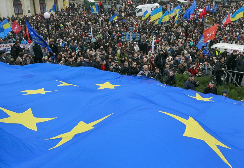 Protesters hold a EU flag as they take part in a rally to support EU integration in central Kiev